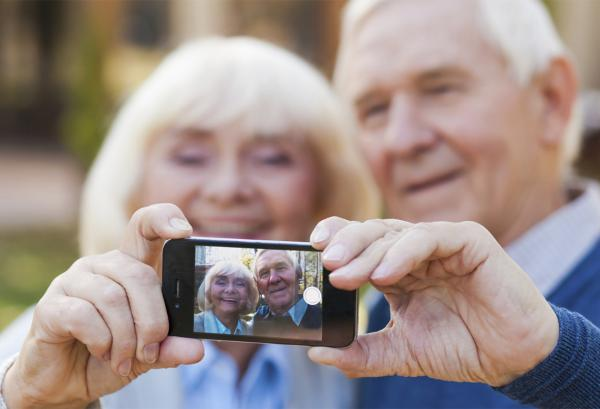 Older couple taking selfie